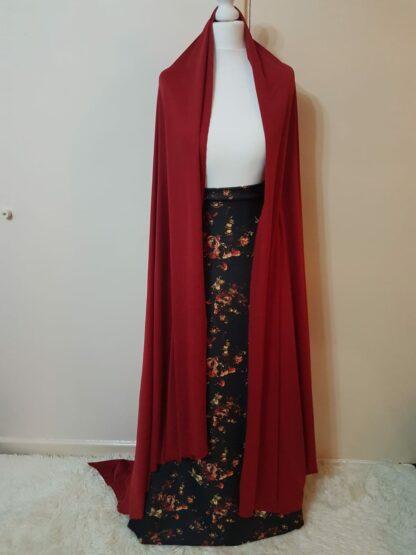 Maroon jacket with black floral skirt